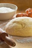 Dough on wooden board. Stock Image