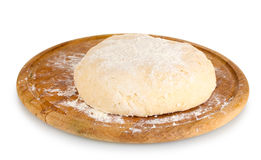 Dough on wooden board stock image