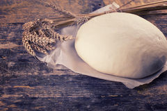 Dough on wooden board Royalty Free Stock Image