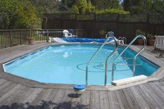 Doughboy Pool. An above ground Doughboy swimming pool surrounded by decking royalty free stock photography