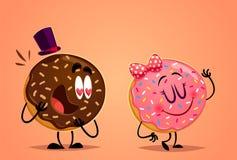 Doughnut αγόρι και κορίτσι Στοκ Φωτογραφίες