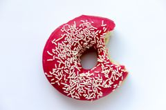 Doughnut με ένα στοματικό δάγκωμα πουφαγώθηκε στοκ φωτογραφία