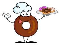 Doughnut που φορά ένα καπέλο αρχιμαγείρων και που εξυπηρετεί donuts Στοκ φωτογραφία με δικαίωμα ελεύθερης χρήσης