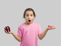 Doughnut ή Apple Στοκ Φωτογραφία