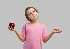 Doughnut ή Apple Στοκ φωτογραφίες με δικαίωμα ελεύθερης χρήσης