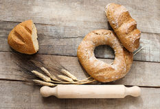 Doughnut bread and cereal french bread over wood Royalty Free Stock Photos