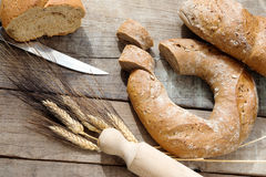 Doughnut bread and cereal french bread over wood Royalty Free Stock Images
