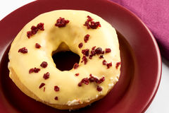 Doughnut with cherry Stock Images