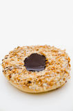 Doughnut with chocolate and crushed nuts Stock Photography