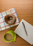 Doughnut coffee and notepad with pen Royalty Free Stock Photography
