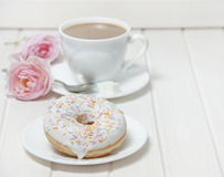 A doughnut and a cup of tea Stock Image