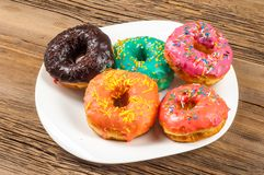 Doughnut, dough-boy, sinker, fritter. A small fried cake of sweetened dough, typically in the shape of a ball or ring royalty free stock photos