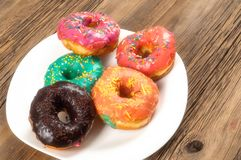 Doughnut, dough-boy, sinker, fritter. A small fried cake of sweetened dough, typically in the shape of a ball or ring. In the classic soft focus camera royalty free stock image