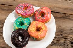 Doughnut, dough-boy, sinker, fritter. A small fried cake of sweetened dough, typically in the shape of a ball or ring royalty free stock photography