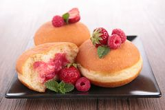 Doughnut. With fresh berry on plate Stock Images