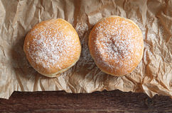 Doughnut with icing sugar Stock Images