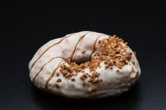 Doughnut with nuts Royalty Free Stock Photo