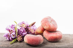 Doughnut Peaches. And acacia flowers stock photography