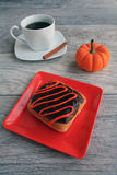 Doughnut peanut butter square with spice pumpkin coffee above Royalty Free Stock Photo