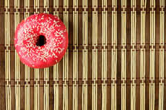 Doughnut in a pink glaze Stock Image
