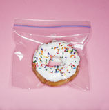 Doughnut in Plastic Bag Royalty Free Stock Photography