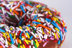 Doughnut with Sprinkles. Glazed donut with sprinkles royalty free stock images