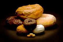 Doughnut Stack. A stack of various size doughnuts Royalty Free Stock Photo