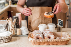 Doughnut Store Counter. Donuts with Icing Sugar in a Display Basket Royalty Free Stock Images