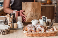 Doughnut Store Counter. Donuts with Icing Sugar in a Display Basket, copy space for your text Royalty Free Stock Photos