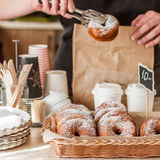 Doughnut Store Counter. Donuts with Icing Sugar in a Display Basket, square Royalty Free Stock Photo