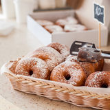 Doughnut Store Counter. Donuts with Icing Sugar in a Display Basket, square royalty free stock photography