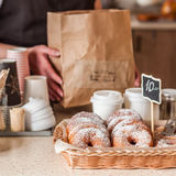 Doughnut Store Counter. Donuts with Icing Sugar in a Display Basket, square Royalty Free Stock Images