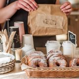 Doughnut Store Counter. Donuts with Icing Sugar in a Display Basket, square Stock Photos