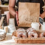 Doughnut Store Counter. Donuts with Icing Sugar in a Display Basket, square Stock Image