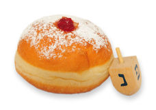 Doughnut on white background. A doughnut and spinning top for the Jewish holiday of Hanukkah are isolated on a white background Stock Photography