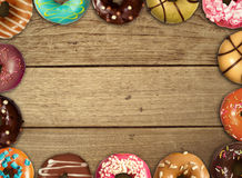 Doughnut on wood table. Colourful doughnut surround the wood table Stock Photos