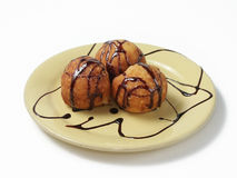 Doughnuts. Air balls from cottage cheese with a chocolate syrup Royalty Free Stock Image