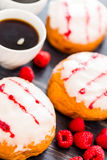Doughnuts. Fresh raspberry jelly filled donuts with white glazing on top Royalty Free Stock Image