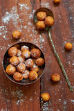 Doughnuts. Tasty small round doughnuts with powdered sugar from above Royalty Free Stock Photos