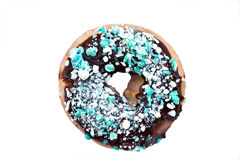 Doughnuts. Tempting chocolate covered doughnut covered with mint candy. Clipping path included Royalty Free Stock Images