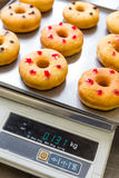 Doughnuts with assorted filling on metal tray Stock Photo