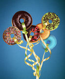 Doughnuts - Balloons. Photo manipulation: doughnuts floating like balloons in a blue background Stock Photos