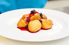 Doughnuts and berries sauce Royalty Free Stock Photo