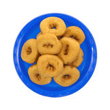 Doughnuts on blue plate Royalty Free Stock Photography