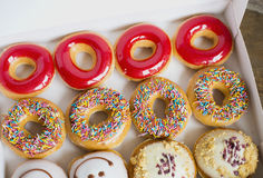 Doughnuts in a box. Multi-colored donuts in a box stock photos