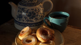 Doughnuts. Breakfast doughnuts with tea - a small, circular cake, fried in hot fat, either with a hole in the middle or filled with jam stock photos