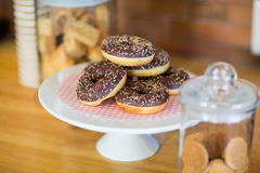 Doughnuts on cake stand Stock Images