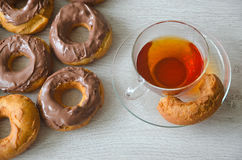 Doughnuts. With chocolate and a cup of tea Royalty Free Stock Photo