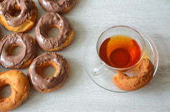 Doughnuts. With chocolate and a cup of tea Stock Photo