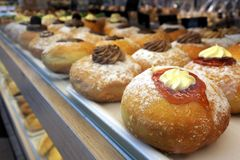 Doughnuts Confection in confectionery store stock photos